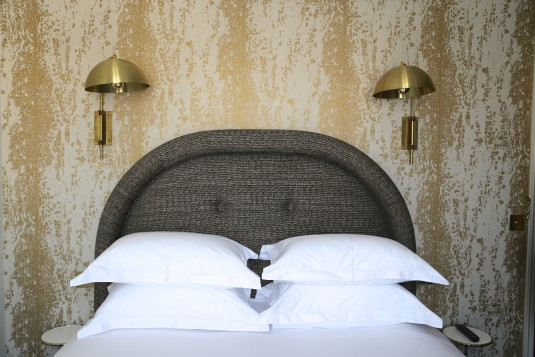 Rooms at the Grand Pigalle feature textured wallpaper.