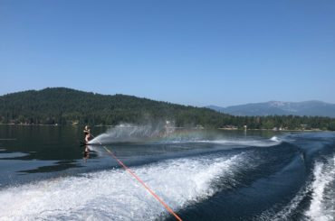 Image of Casey Hatfield-Chiotti water skiing on Lake Pend Oreille in Northern Idaho