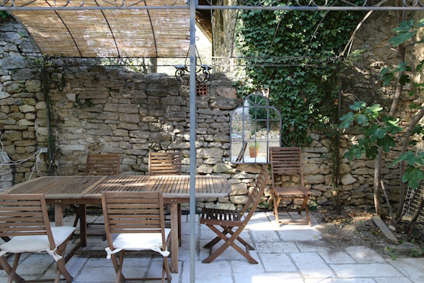 Maison Noel's back patio is the perfect place to enjoy a glass of rosé.