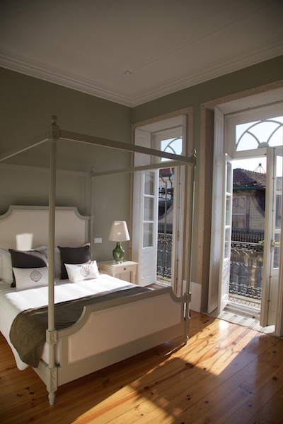 Guest rooms at Porto Vintage Guesthouse have hardwood floors and high ceilings but cost around 100 euros a night.