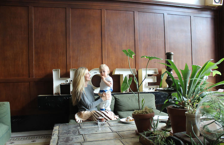 Image of Casey Hatfield-Chiotti and her son Wylie in the lobby of the Ace Hotel in Portland, Oregon