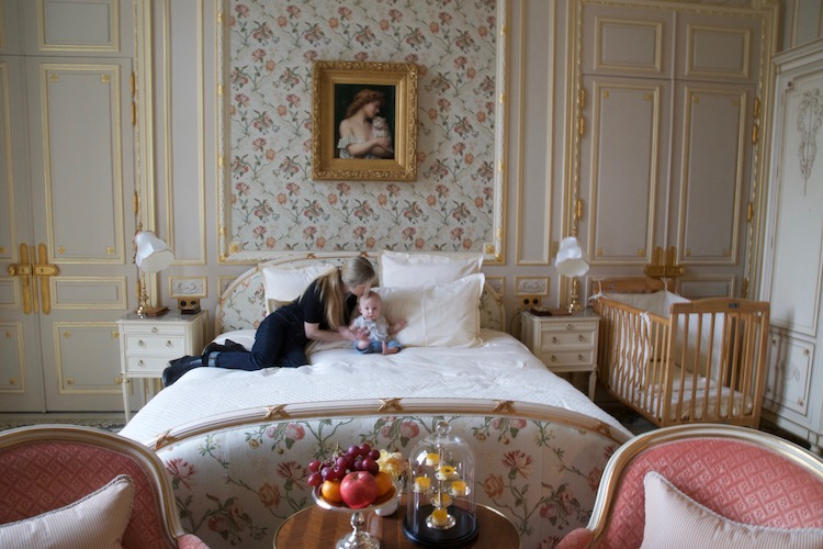 Image of writer Casey Hatfield-Chiotti and her son in a suite at the Ritz Paris