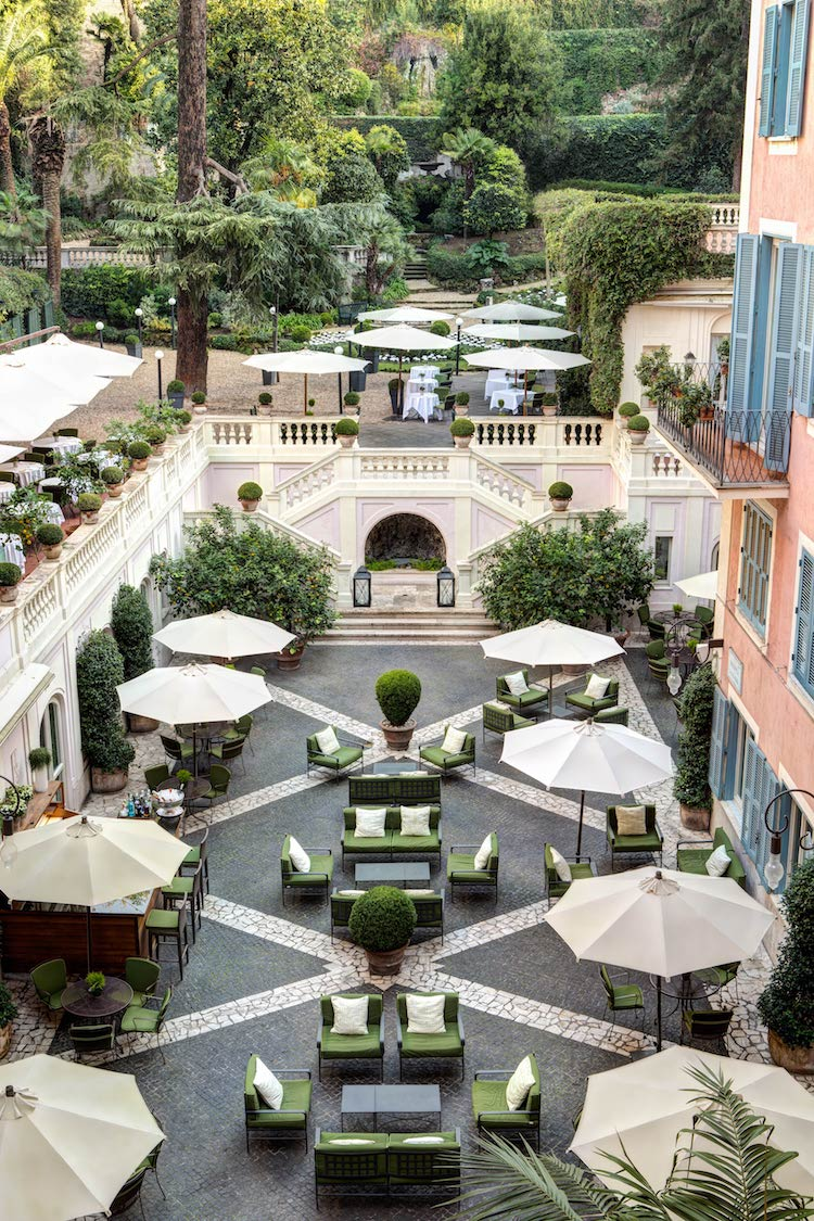 The courtyard at Hotel de Russie, one of the most luxurious hotels in Rome